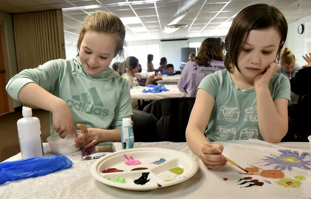 Izabel Hamilton, left, and her sister Charlotte make slime Wednesday during April Fun Camp  at the Skowhegan Community Center.