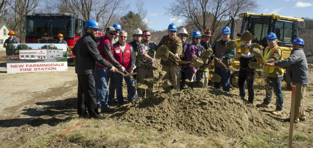 Town officials, firefighters, donors and contractors toss dirt Wednesday during a ceremonial groundbreaking for a new Farmingdale fire on Maine Avenue in Farmingdale.