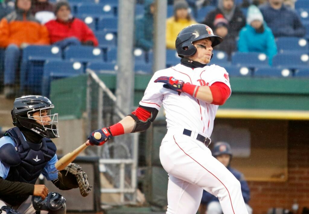 PORTLAND, ME - APRIL 18: Sea Dogs #3 Brett Netzer follows through on a swing in the first inning vs. Trenton Thunder at Hadlock Field. (Staff photo by Jill Brady/Staff Photographer.)