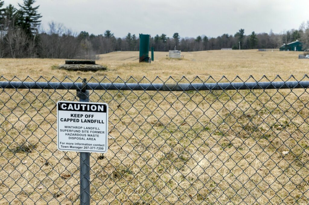 A chain-link fence blocks access to the Winthrop landfill Superfund site, shown Friday.