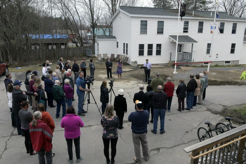 People gather Monday at Bread of Life Ministries in Augusta. The nonprofit hosted a ribbon-cutting ceremony to celebrate adding 14 beds to the existing 26-bed family shelter, as well as the kitchen and additional space at the nearby veterans' shelter, which is the only one of its kind in Maine.