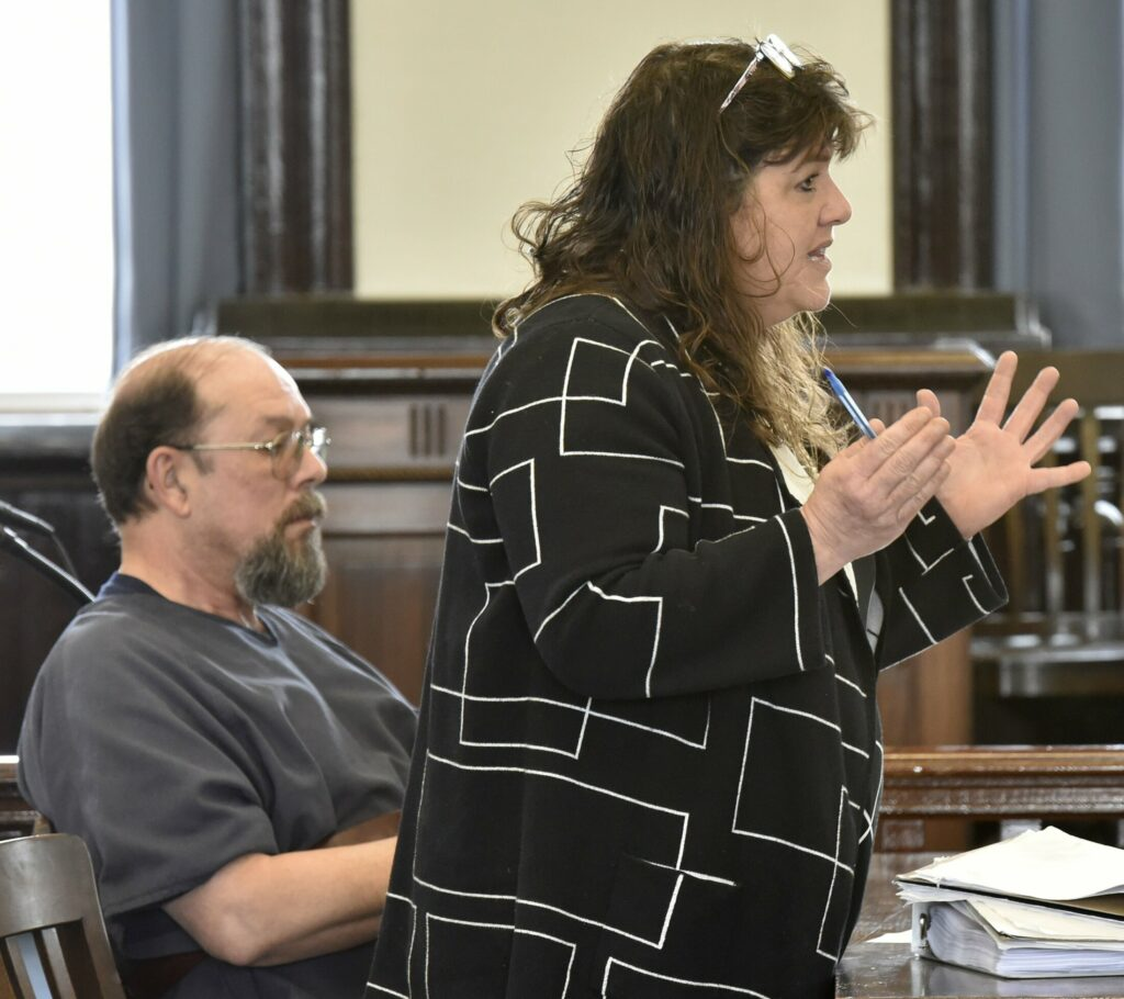 Jay Mercier listens as his attorney, Amy Fairfield, makes a point Monday in Somerset County Superior Court in Skowhegan during the first day of his appeal of his conviction for the murder of Rita St. Peter.