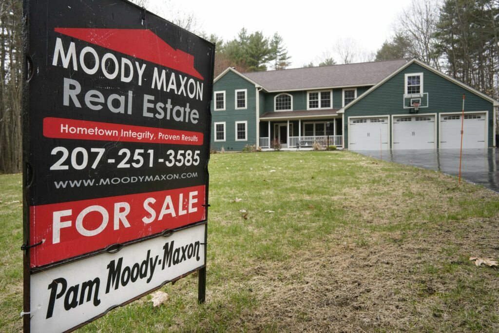 A for sale sign stands in the yard of a home on Carriedale Lane in Kennebunk in April. Home sales, which had been flat at the start of the year, are rebounding.