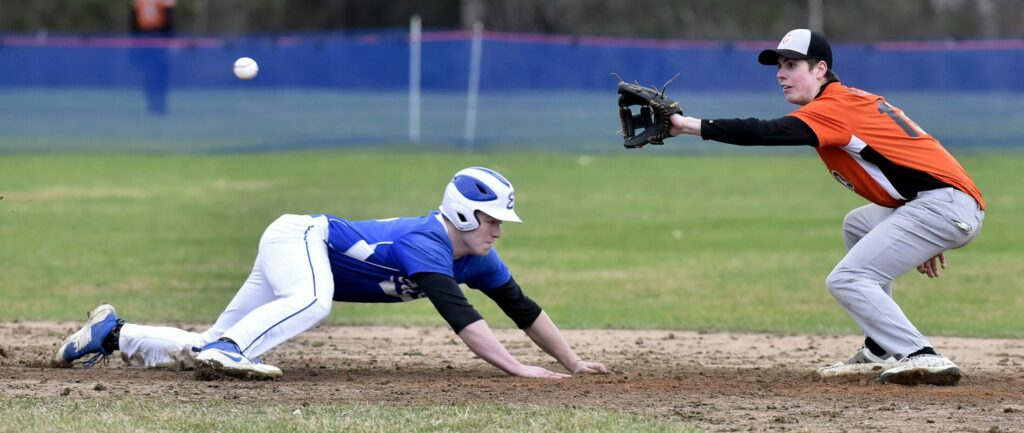 Erskine's Joe Clark dives back to second base as Gardiner's Michael Meehan attempts to make the out Wednesday in South China.