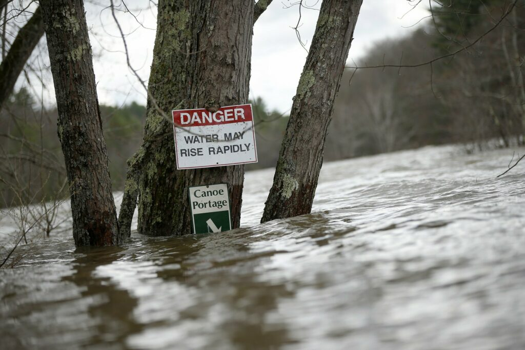 Water floods the canoe portage directly below the Saco River Reservoir near River Road in West Buxton on Wednesday.