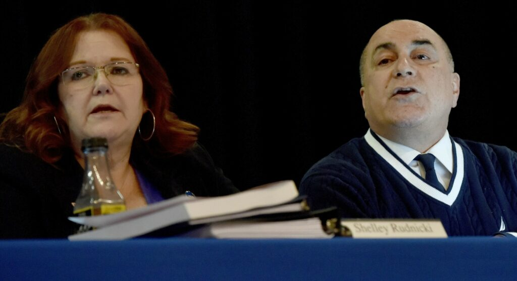 SAD 49 Superintendent Reza Namin spoke during a school board meeting filled with students, faculty and parents in Fairfield on Thursday. At left is chairwoman Shelley Rudnicki.