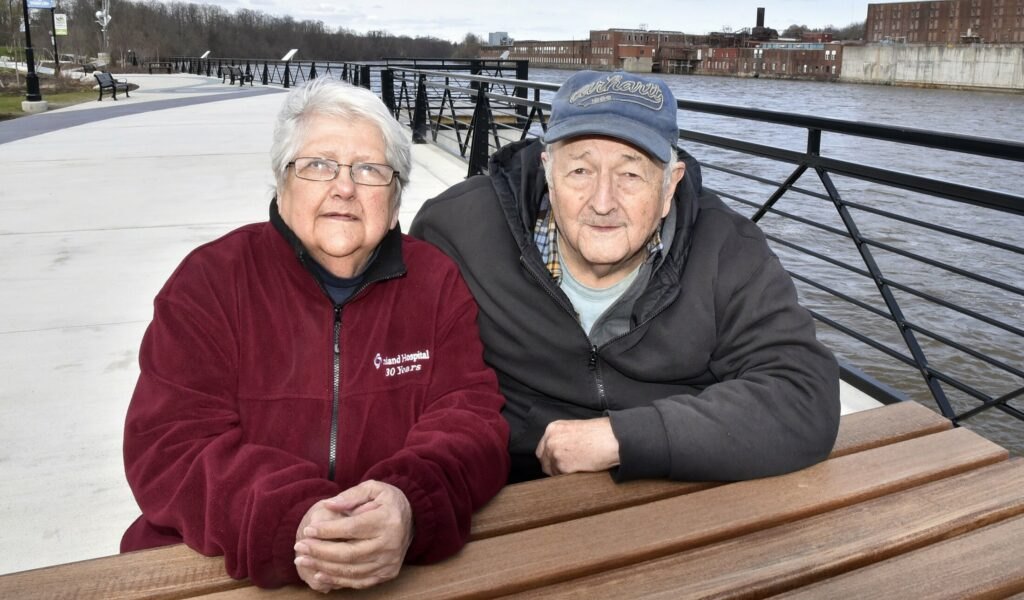 Vicky LaBrie and Clarence Spaulding enjoy an outing at the RiverWalk at Head of Falls in Waterville on April 28.