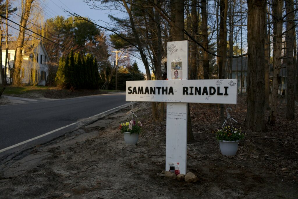 The four children of Samantha Rinaldi of Gray erected a cross in her memory on Yarmouth Road in Gray on April 28.