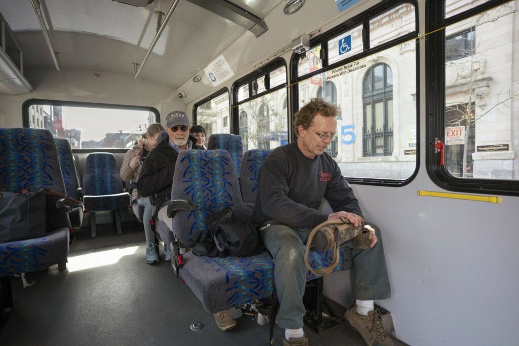 Mike Spaulding of Brunswick pours coffee from his thermos while riding the Breez commuter bus along Congress Street in Portland on Monday. The Breez has been more successful than anticipated and Portland Metro is proposing to make the bus route to the northern suburbs permanent.
