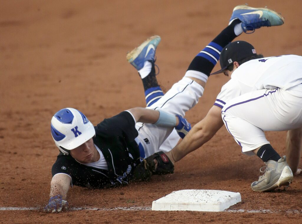 Kennebunk's Nick Teguis in tagged out at third base by Deering's Michael Randall during Kennebunk's 20-2 victory on Tuesday night at Hadlock Field.