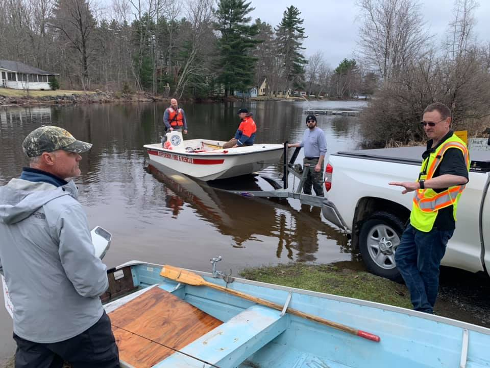 David Reiss, left, stands with members of Jefferson Fire and Rescue after he saved a man whose boat had capsized Monday in Damariscotta Lake.