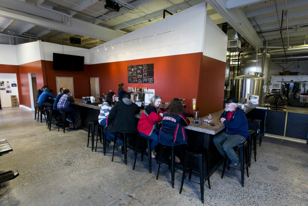 Rising Tide Brewing, photographed soon after the expansion of its tasting room in 2016, has operated under a license that allows it to sell gluten-free drinks, such as cider and wine, in addition to its beer. That license requires that 10 percent of the revenue come from food sales. Rising Tide's food sales account for only 9 percent.