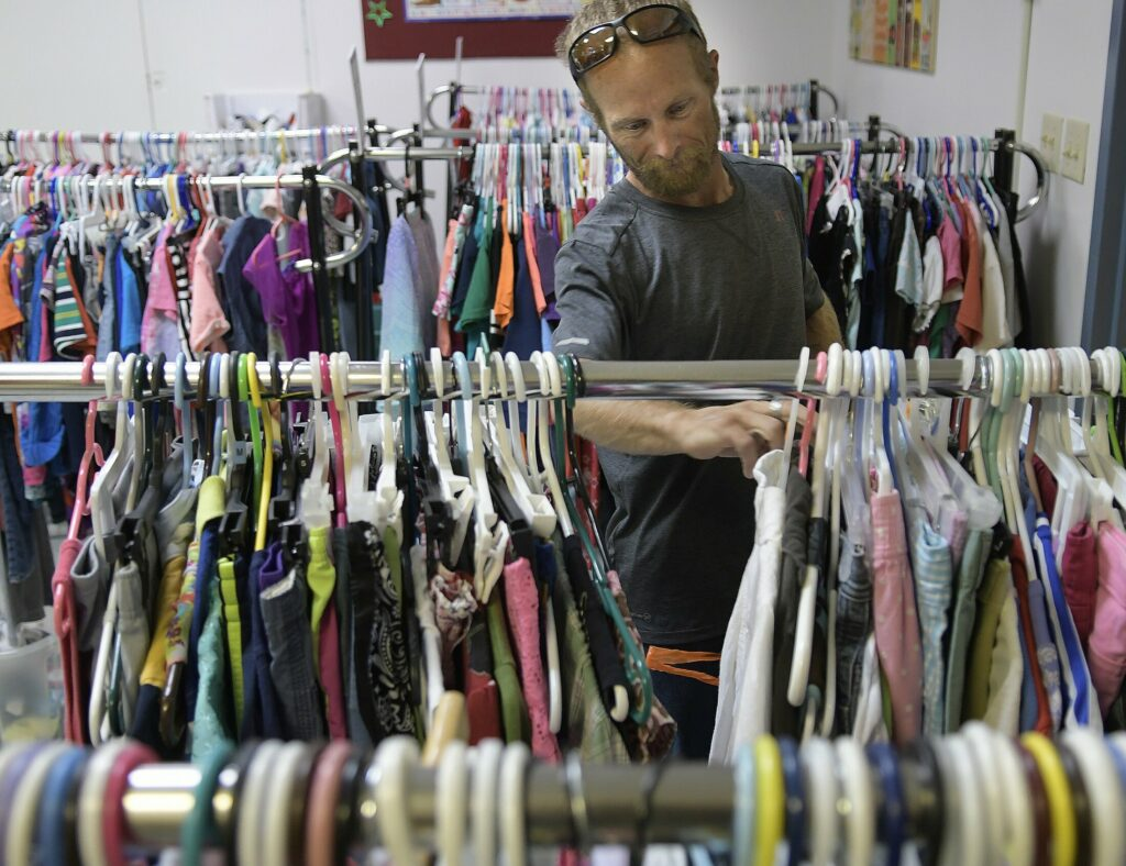 Joseph McKenna shops for clothing July 26 at Bridging the Gap, an Augusta nonprofit organization that oversees Addie's Attic clothing bank, Everyday Essentials toiletries pantry and, in the winter, Augusta Community Warming Center.