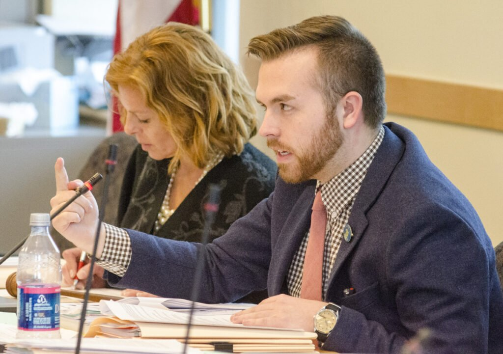 Rep. Ryan Fecteau, D-Biddeford, photographed at a hearing last year, is sponsoring the bill that would ban therapy practices for minors that use shame, pain or coercion to alter a person's sexual orientation.