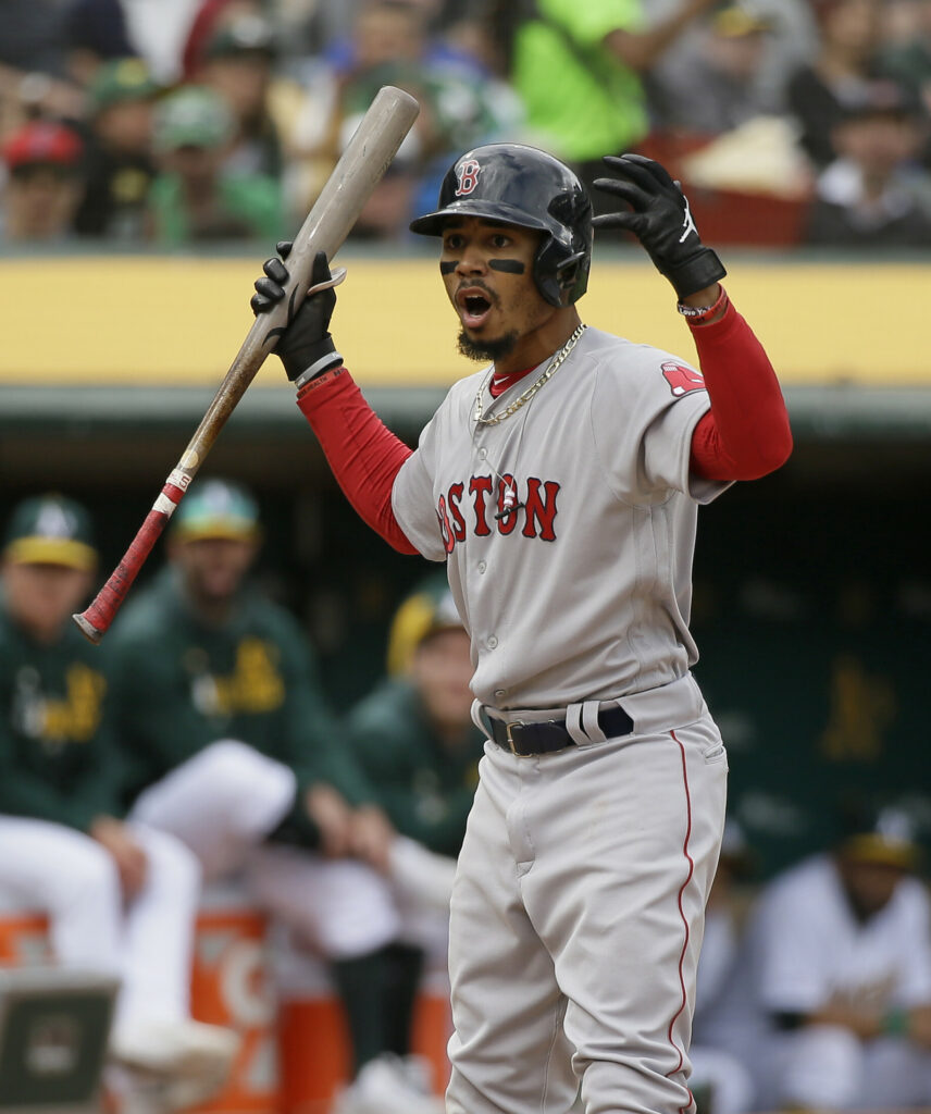 Mookie Betts shows his disbelief after taking a called third strike Thursday against the Oakland Athletics. Betts also was thrown out on the bases and was involved in an outfield misplay, and Boston lost, 7-3.