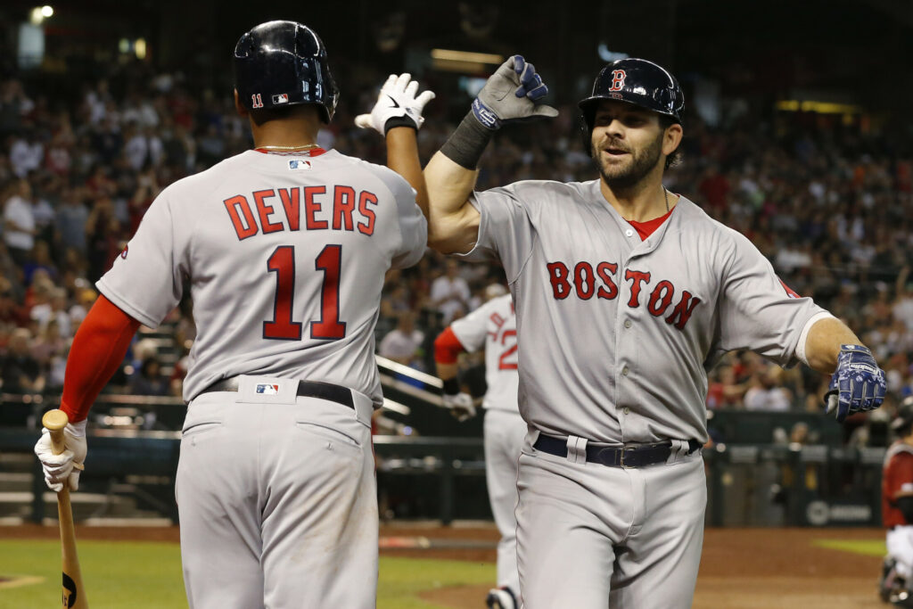 Mitch Moreland, right, celebrates with Rafael Devers, after Moreland hit a solo home run in the seventh inning to lift the Red Sox to a 1-0 win on Sunday in Phoenix.