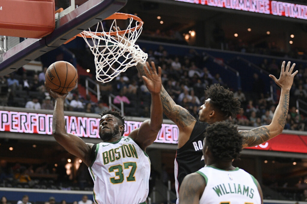 Boston Celtics forward Semi Ojeleye (37) goes to the basket against Washington Wizards forward Devin Robinson, back right, during the first half of an NBA basketball game, Tuesday, April 9, 2019, in Washington. Celtics center Robert Williams III is at bottom right. (AP Photo/Nick Wass)