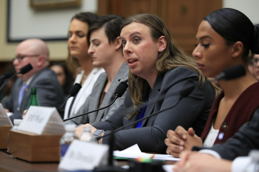 In this Feb. 27, 2019 file photo, Army Staff Sgt. Patricia King, second from right, together with other transgender military members, from left, Navy Lt. Cmdr. Blake Dremann, Army Capt. Alivia Stehlik, Army Capt. Jennifer Peace and Navy Petty Officer Third Class Akira Wyatt, testify about their military service before a House Armed Services Subcommittee on Military Personnel hearing on Capitol Hill in Washington.