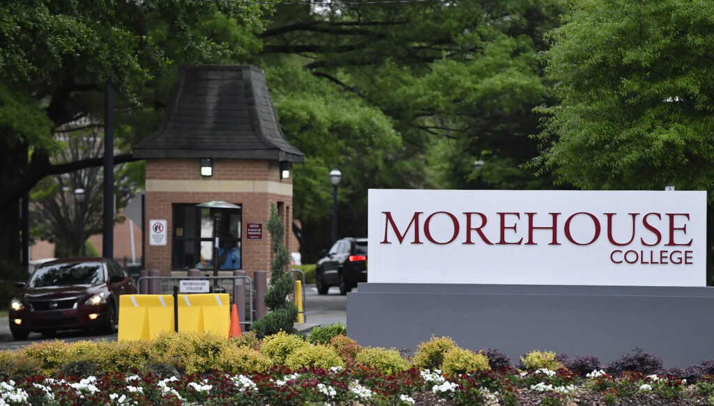 In this Friday, April 12, 2019 photo, people enter the campus of Morehouse College in Atlanta. Morehouse College, the country's only all-male historically black college, will begin admitting transgender men next year. The move marks a major shift for the school at a time when higher education institutions around the nation are adopting more welcoming policies toward LGBT students.