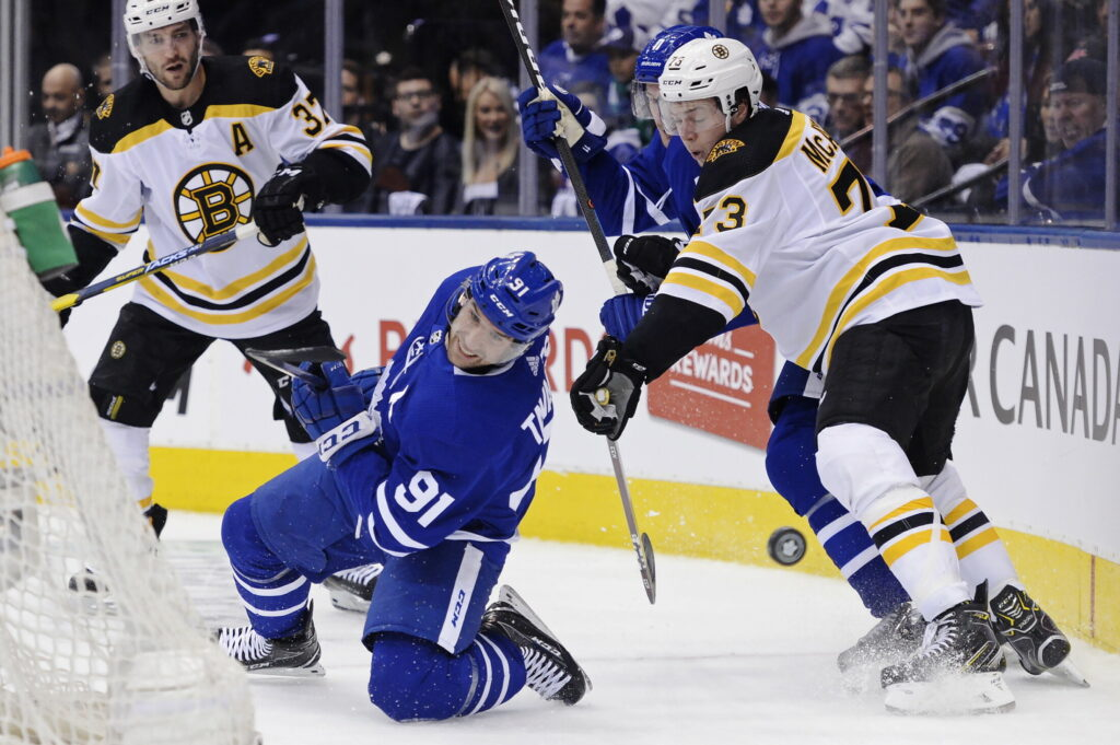 Boston Bruins defenseman Charlie McAvoy takes down Toronto Maple Leafs center John Tavares during Game 3 of their first-round playoff series on Monday in Toronto. The Maple Leafs won 3-2 to take a 2-1 series lead.