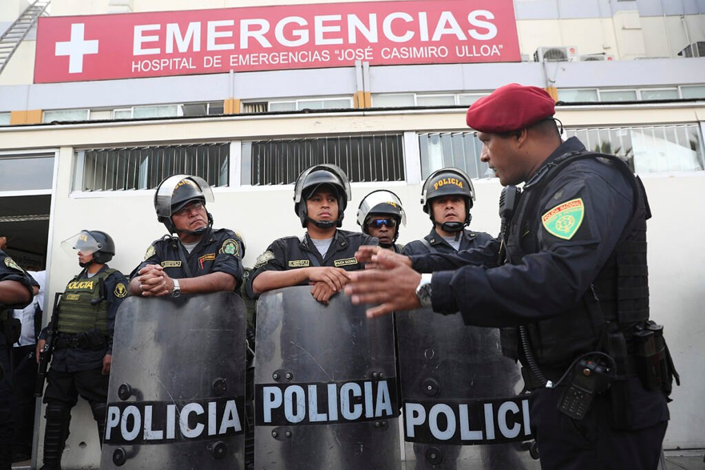 Peru's police officers stand guard at the emergency hospital Casimiro Ulloa where former Peruvian President Alan Garcia was taken after he shot himself in his neck, in Lima, Peru, Wednesday, April 17, 2019.   Garcia shot himself before being detained by police.