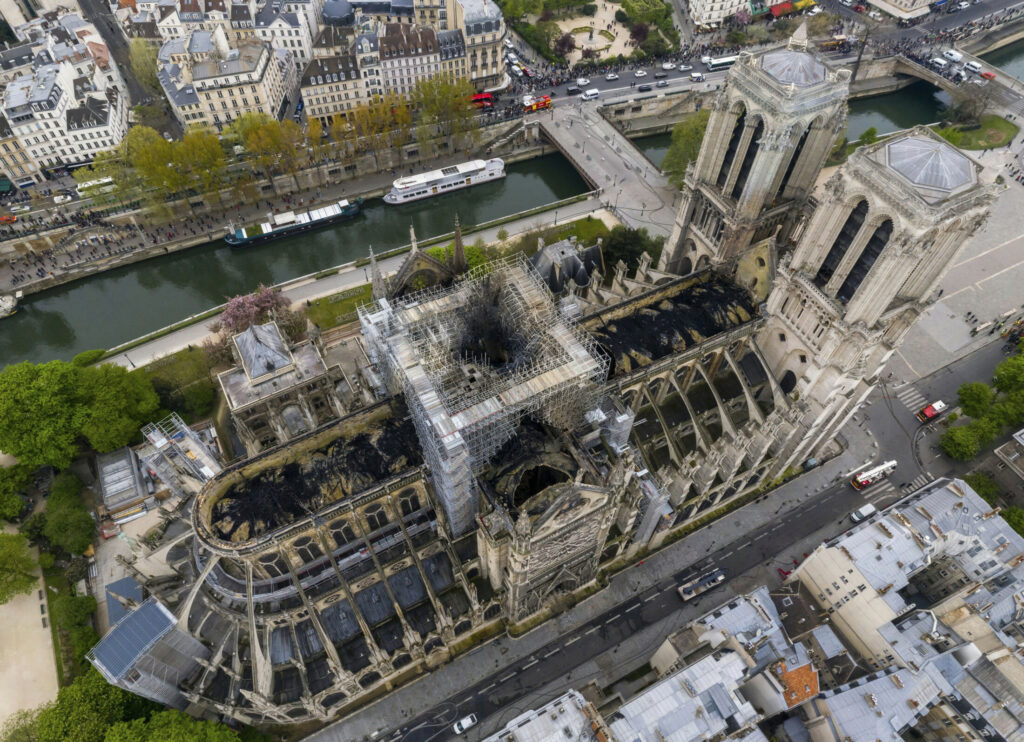 An aerial photo shows fire damage to Notre Dame cathedral in Paris on Tuesday. Nearly $1 billion has already poured in from ordinary worshippers and high-powered magnates around the world to restore Notre Dame Cathedral in Paris after it was damaged in a massive fire on Monday.