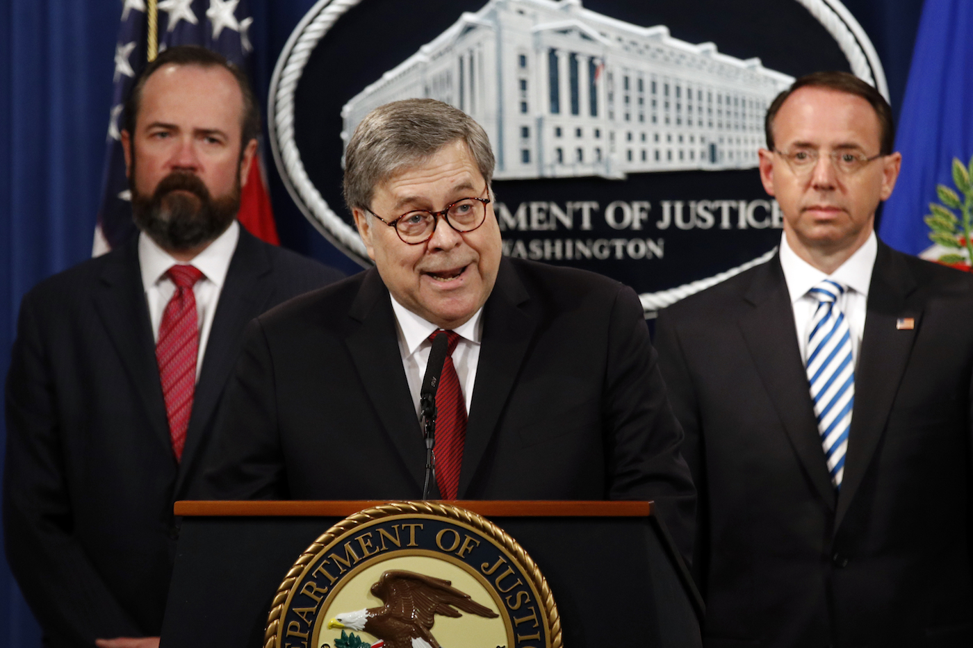 Attorney General William Barr speaks alongside Deputy Attorney General Rod Rosenstein, right, about the release of a redacted version of special counsel Robert Mueller's report during a news conference on April 18.