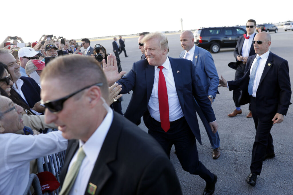 President Trump greets people at Palm Beach International Airport on Thursday in West Palm Beach, Fla. Trump is spending the Easter weekend as his Mar-a-Lago estate.