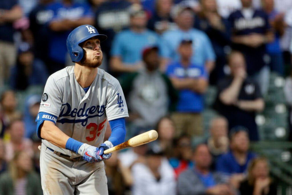 Cody Bellinger of the Los Angeles Dodgers watches the ball leave the park Sunday – a winning home run in the ninth inning of a 6-5 victory against the Milwaukee Brewers.(AP Photo/Aaron Gash)