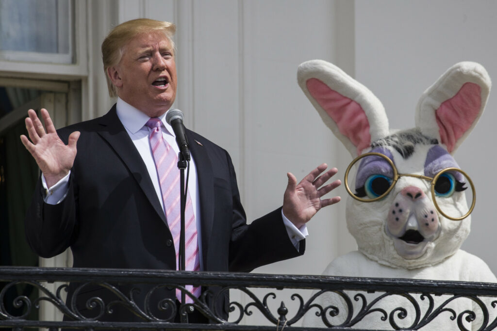 President Donald Trump, joined by the Easter Bunny, speaks from the Truman Balcony of the White House in Washington, Monday, April 22, 2019, during the annual White House Easter Egg Roll.