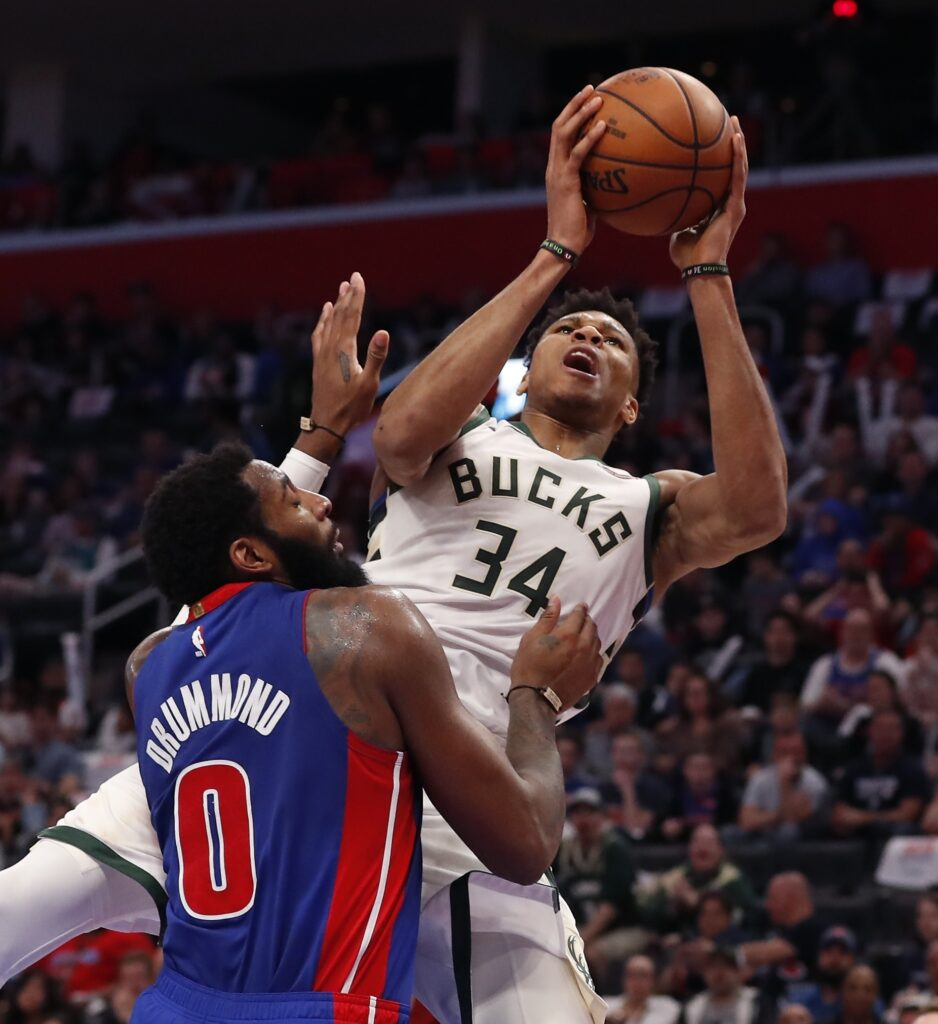 Milwaukee forward Giannis Antetokounmpo is fouled by Detroit center Andre Drummond during the first half of the Bucks' 127-104 win Monday night in Detroit. The Bucks won the series 4-0 and advances to play Boston in the Eastern Conference semifinals.