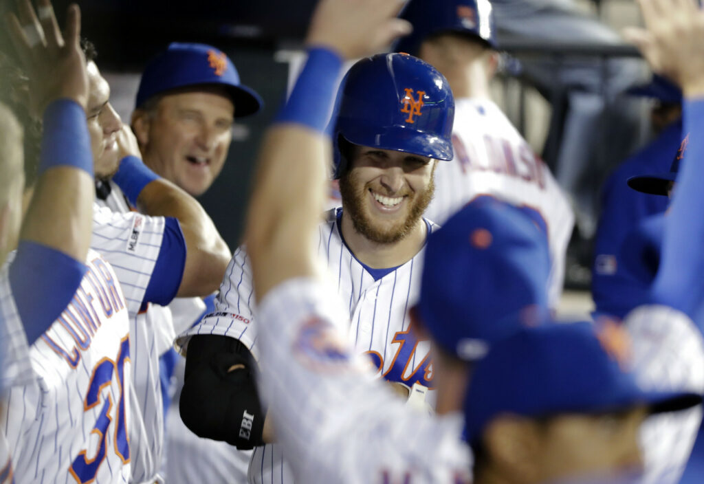 Mets starting pitcher Zack Wheeler is congratulated after hitting his first major league home run in New York's 9-0 win over Philadelphia on Tuesday in New York.