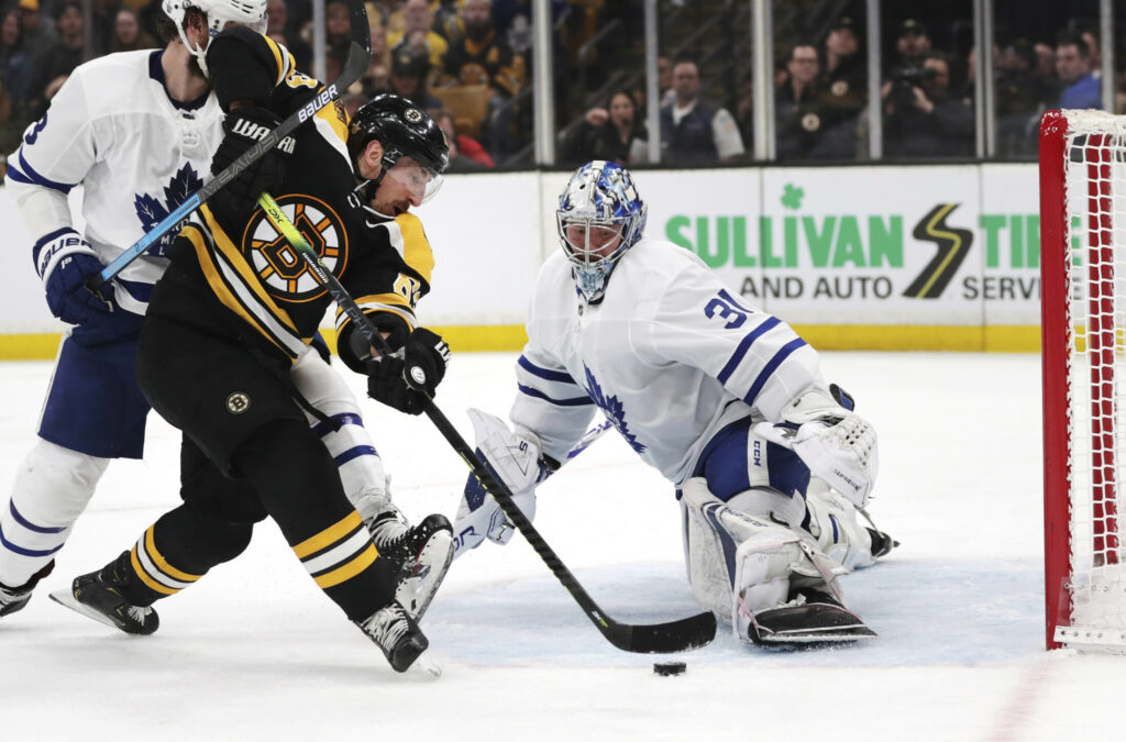 Bruins left wing Brad Marchand, left, tries unsuccessfully to shoot past Maple Leafs goaltender Frederik Andersen Tuesday night in Game 7. The Bruins won to advance to the second round. Game 1 vs. Columbus is Thursday night at Boston.