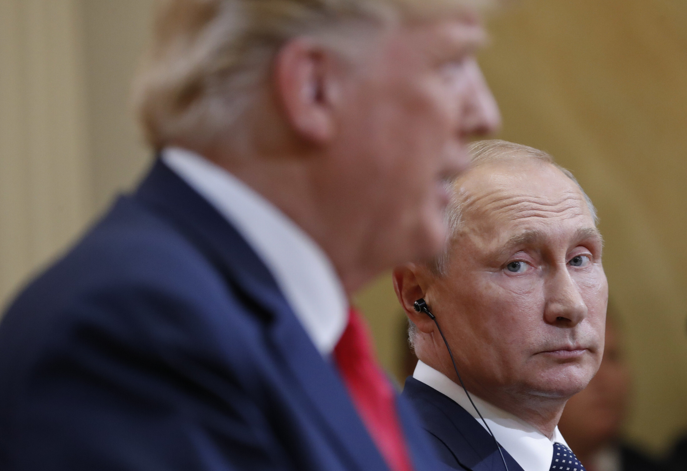 Russian President Vladimir Putin looks toward U.S. President  Trump during their joint news conference at the Presidential Palace in Helsinki, Finland, in 2018.
