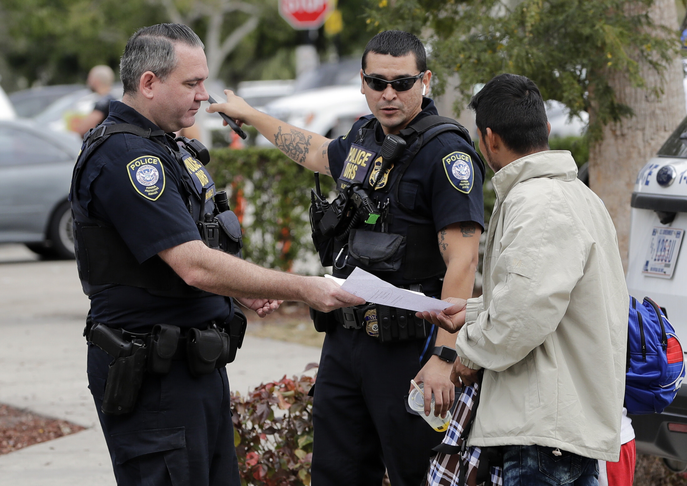 Homeland Security police direct people where to go outside a U.S. Immigration and Customs Enforcement facility this year in Miramar, Fla. Maine lawmakers are considering two bills with different policies on how local police officers would interact with federal immigration officers.