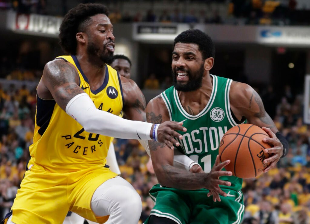 Celtics guard Kyrie Irving, right, is fouled by Pacers guard Wesley Matthews, left, during Game 4 of their Eastern Conference first-round playoff series on Sunday in Indianapolis. The Celtics won 110-106 to win the series 4-0.