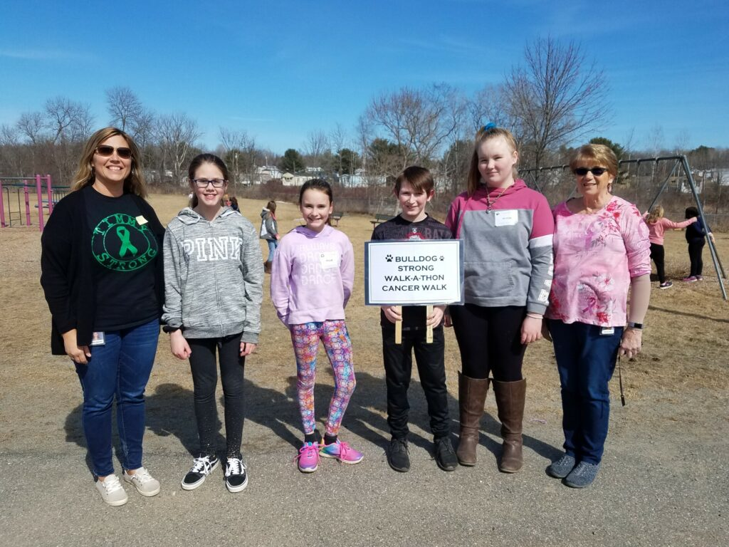 Clinton Elementary School's Student Council recently led the school in a Bulldog Strong Walk-athon Cancer Walk for the American Cancer Society. Students and staff carried with them lists of names of the people they know or have known who had cancer. More than $1,002 was raised. From left are Kelley Cloutier, co-advisor, with sixth-grade members Kaylie Smith, Kylie Delile, Colton Carter, Alyssa Carter and Marcia Buck, co-advisor.