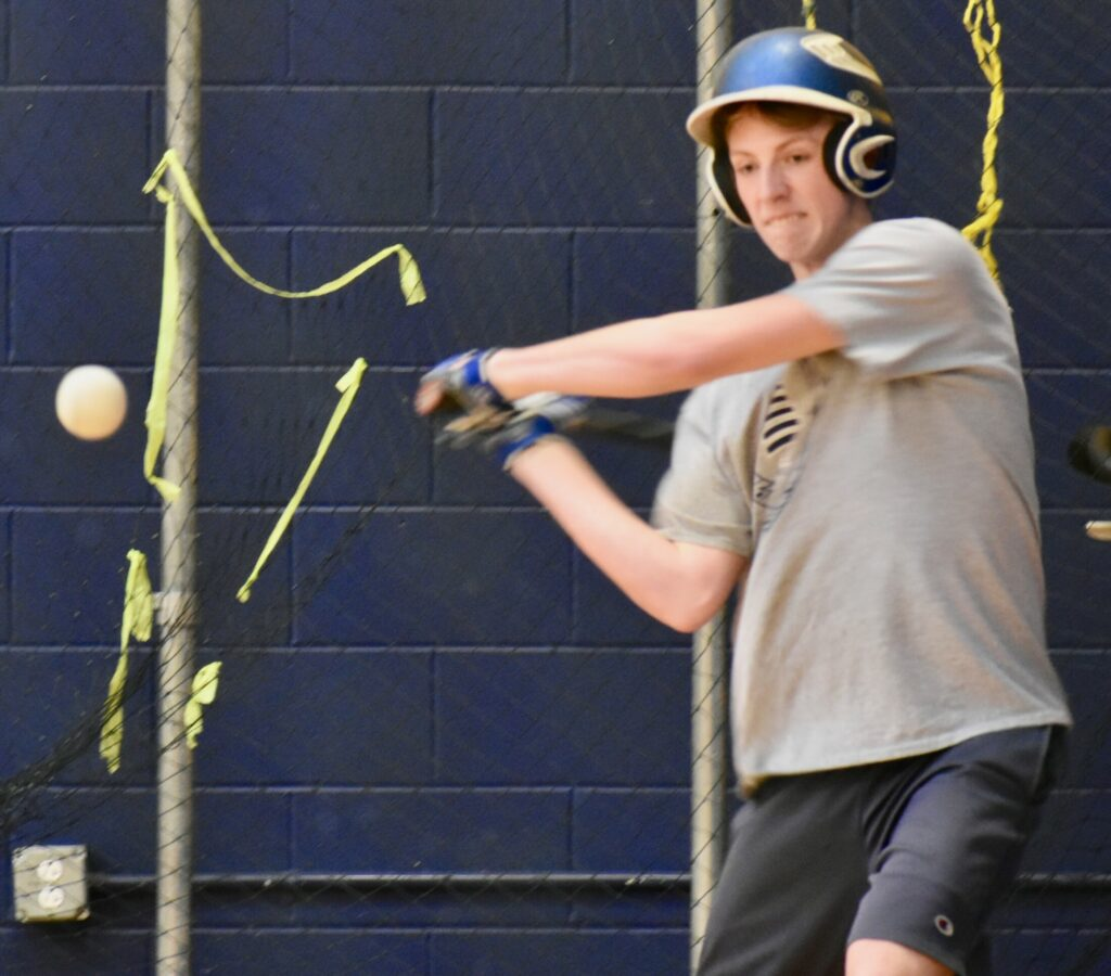 A Mt. Blue player takes a swipe at the baseball in the batting cages. (Franklin Journal photo by Tony Blasi)