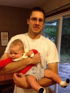 David Dieterich, 35, holds his nephew Henry. Dieterich was on a temporary work assignment in Bath and exploring the city when he stepped onto an unstable dock near the Kennebec Tavern last Thursday and fell into the Kennebec River.