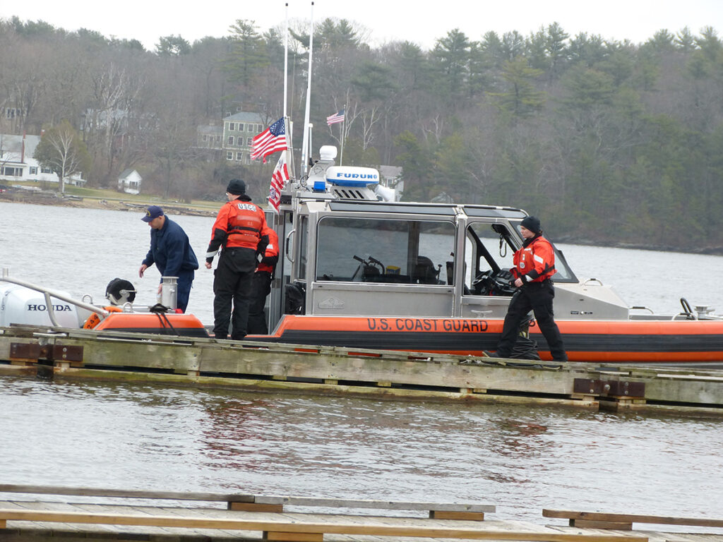 Maine Marine Patrol and U.S. Coast Guard boats and personnel searching the Kennebec River on April 19, the day after David Dieterich slipped and fell into the river.