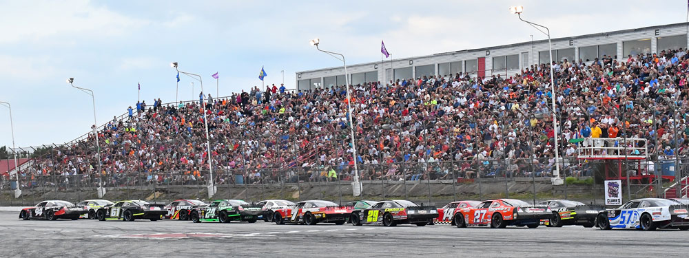Cars and fans get ready for the start of the Oxford 250 at Oxford Plains Speedway last summer. Car counts aren't as high as they once were, but the quality of the race has not suffered.