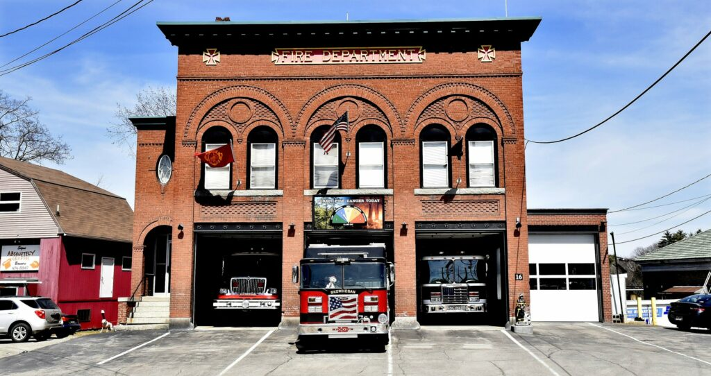 When firetrucks leave the century-old Skowhegan fire station — shown in April 2018 — on their way to a fire, some of them will be able to communicate better with the aid of new noise-cancelling headsets. The department is trying to acquire more of them. Staff file photo by David Leaming