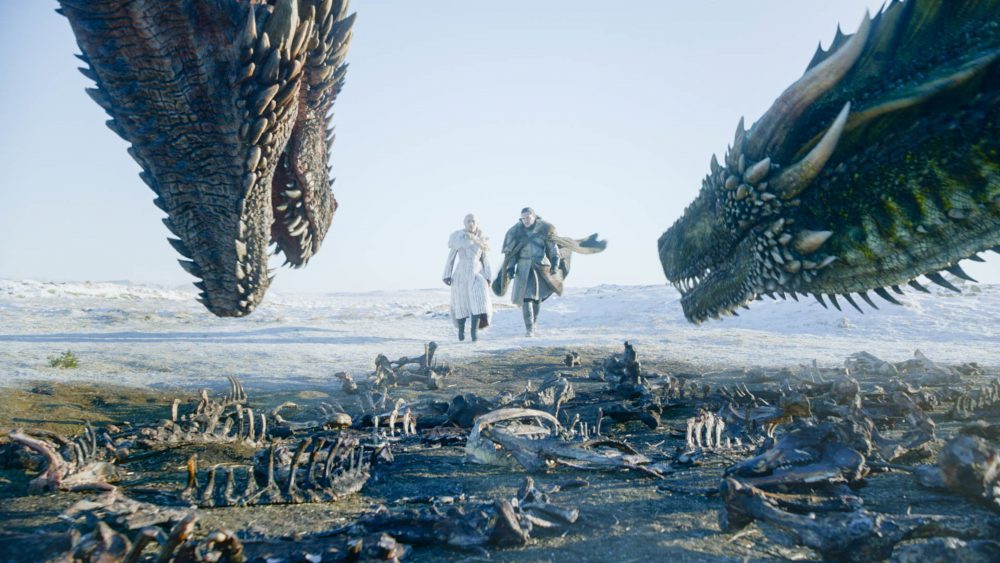 """This image released by HBO shows Emilia Clarke, left, and Kit Harington in a scene from """"Game of Thrones"""" on Sunday. The first episode of the final season of """"Game of Thrones"""" is a record-breaker for the series and HBO. The pay channel said the 17.4 million viewers who watched Sunday's episode either on TV or online represent a season-opening high for the fantasy saga."""