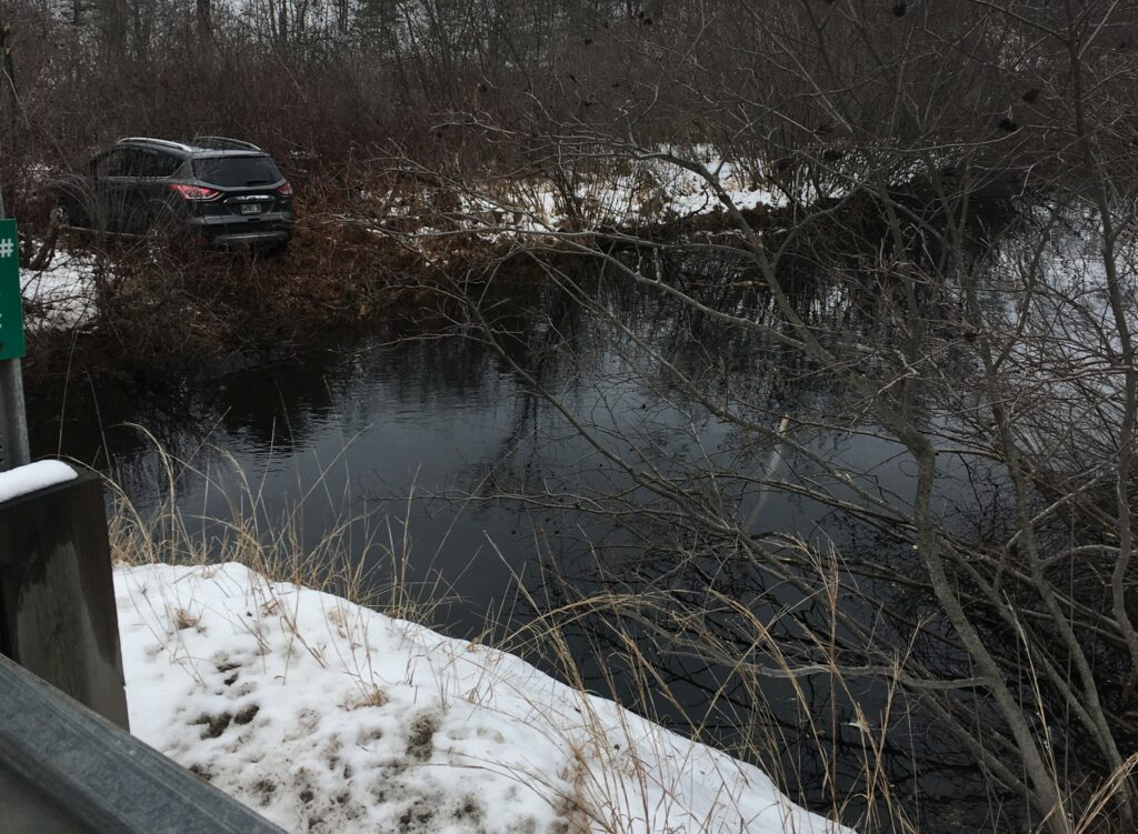 Police say this SUV went off West Road in Waterboro, hit boulders lining a river and flew about 25 to 30 feet, landing on the other side.