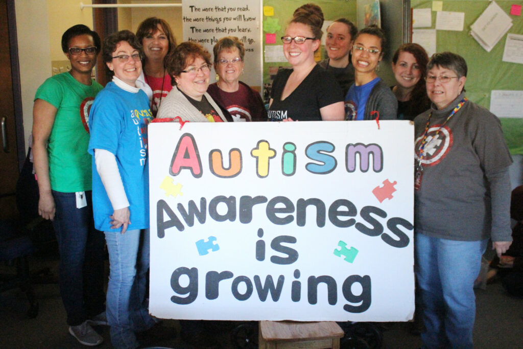 Winslow Elementary School  teachers and facilitators recognize that Autism awareness is growing. In front from left are Samantha Lessard, Joan Brown, Kelsey Steeves, Rachel Leak and Peg Pellerin. Back from left are Nicole DeRoche, Anne Rice, Joan Varney, Anna Collins and Melissa Hanley, head of the Autism Program at the school.