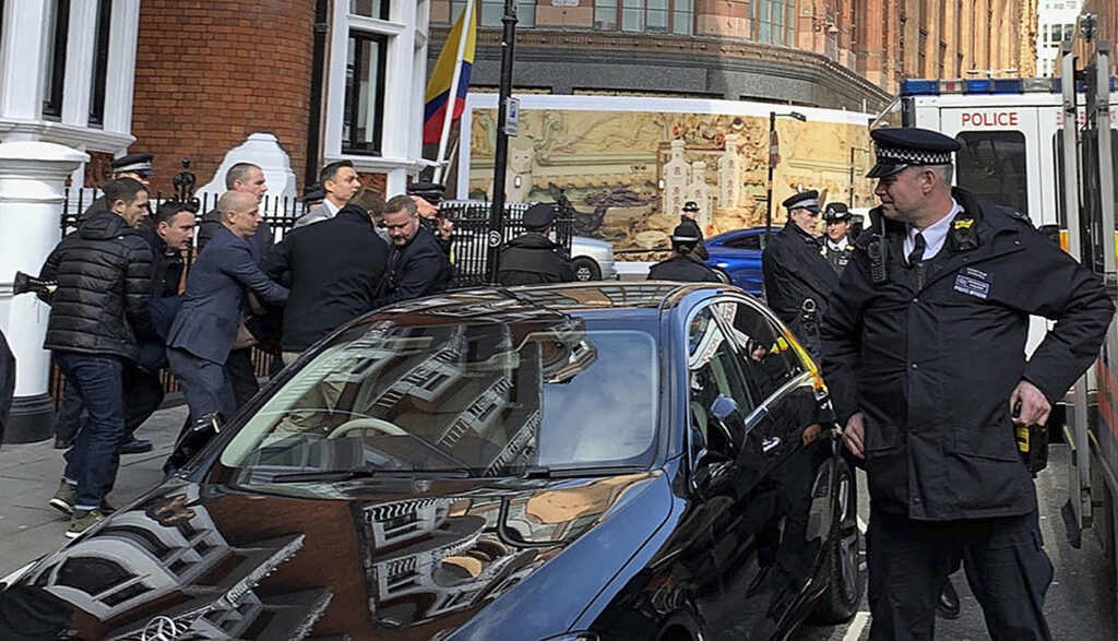 Police carry WikiLeaks founder Julian Assange from the Ecuadorian embassy in London after he was arrested by officers from the Metropolitan Police and taken into custody on Thursday.