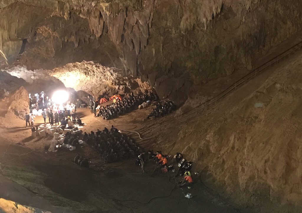 Emergency rescue teams gather in the staging area as they continue the search for 12 young soccer team members and their coach after going missing in a large cave in Thailand in 2018.