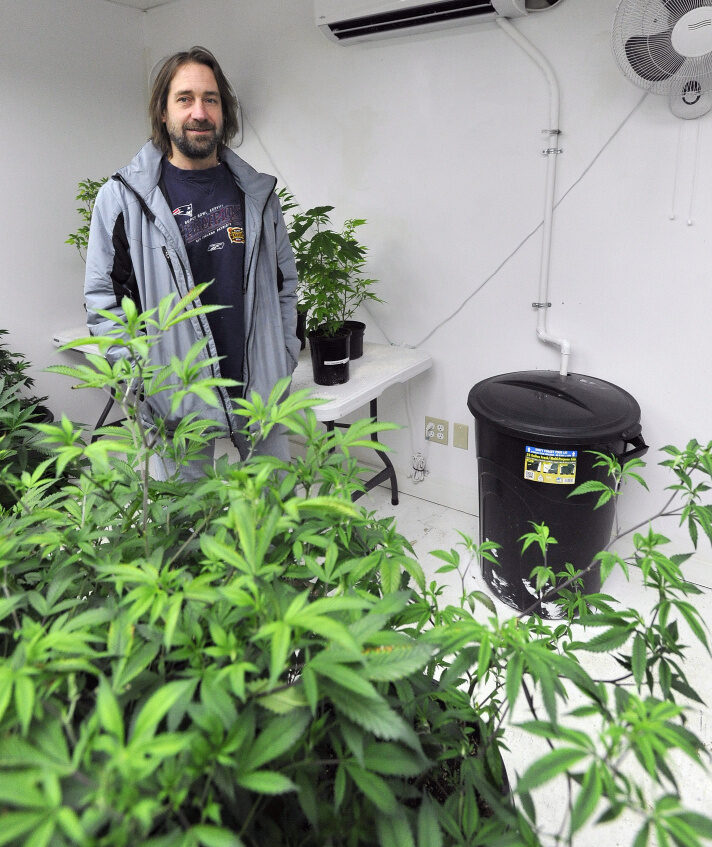 Dawson Julia, a medical marijuana caregiver, stands in a grow room in Unity. While he's glad the state's proposed rules on creating a recreational marijuana market give preference to Maine residents, he said some of the regulations are ambiguous and absurd.