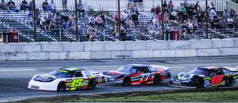 Nick HInkley (15) of Wiscasset leads Nick Reno (77) of West Bath and Kevin Douglass (18) of Sidney during a Pro Stock feature last season at Wiscasset Speedway in Wiscasset. Hinkley and Douglass finished 1-2 in the final point standings.