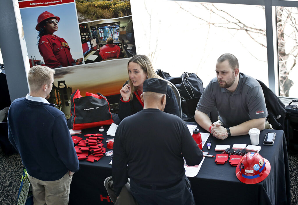 Visitors to the Pittsburgh veterans job fair meet with recruiters at Heinz Field in Pittsburgh in March.